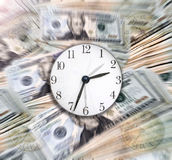 Time & Money. Time and Money. A sharp clock over Money with motion blur/zoom effect in the background Royalty Free Stock Photo
