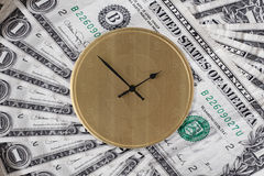 Time is Money - USA Version. Image depicting the concept Time is Money using dollar bills and dollar symbol on clock face Royalty Free Stock Photography