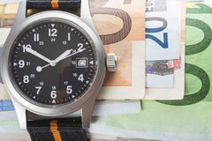 Time is money, watch and banknotes Royalty Free Stock Photo