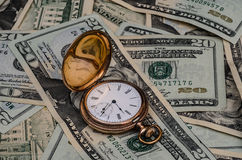 Time is money watch with cash background. Stock Photo