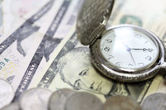 Time is money watch clock on bank Stock Photo