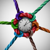 Time Network. Social work coordination as a group of ropes tied and connected together to a central clock as a business organization metaphor or event planning Stock Images