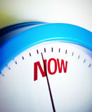 Time is NOW. Clock is showing deadline time. Take action NOW stock photo