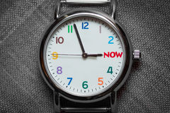 Time is Almost Now. Colorful Watch Shows Time is Now royalty free stock images