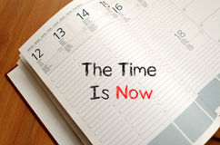The time is now text concept on notebook Royalty Free Stock Photography