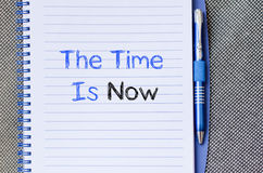 The time is now text concept on notebook Royalty Free Stock Images