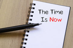 The time is now text concept on notebook Stock Photo
