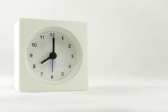 The time is now 8.00 am,  white background. The time is now 8.00 am,  white Royalty Free Stock Image