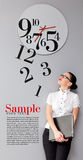 Time in office. Business Woman under the clock. Concept Royalty Free Stock Photos
