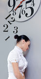 Time in office. Business Woman under the clock. Concept Stock Photography