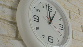 Time one hour. Timelapse. Round white clock hanging on brick wall. stock video footage