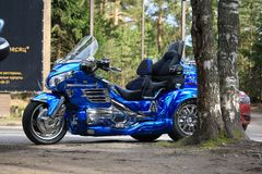 Blue tricycle Honda 1800 Gold Wing near two birches Stock Photos