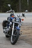 Custom motorcycle Kawasaki Vulcan VN 1500 blue outdoors on a cloudy day. Front view royalty free stock photo