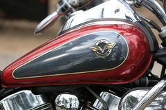 Motorcycle Kawasaki Vulcan VN 1500 red and black. Fuel tank witw emblem close-up Stock Photos