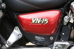 Motorcycle Kawasaki Vulcan VN 1500 red and black. Short close-up model designation Stock Photos