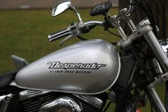 Motorcycle Suzuki VZ400 Desperado silver outdoor. Fuel tank with logo close up stock image