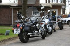 Motorcycles parked near road restaurant in cloudy day stock photos