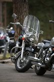 Parked motorcycles in cloudy day close-up Stock Images