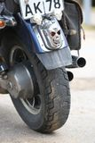 Three skulls. Custom brake light on the rear wheel of a motorcycle. Close up Royalty Free Stock Images