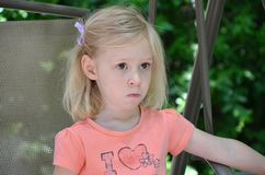 Time out. A little girl is upset to be in a time out for naughty behavior Royalty Free Stock Photography