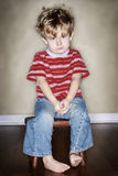 Time Out. A young boy sits on his time out chair Royalty Free Stock Images