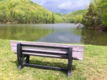 Time out. Bench overlooking Eagle Lake, Morehead KY Royalty Free Stock Photography