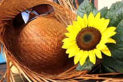 Time out. Closeup of sunglasses, sunflower, and a straw hat Royalty Free Stock Photography