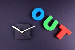 Time out. Concept: Time out . Word out and clock on isolated on dark background Stock Photos
