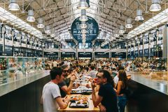 Time Out Market In Lisbon. LISBON, PORTUGAL - AUGUST 12, 2017: Time Out Market is a food hall located in Mercado da Ribeira at Cais do Sodre in Lisbon and is a Royalty Free Stock Images