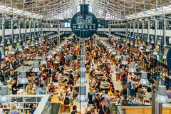 Time Out Market In Lisbon. LISBON, PORTUGAL - AUGUST 12, 2017: Time Out Market is a food hall located in Mercado da Ribeira at Cais do Sodre in Lisbon and is a Stock Image