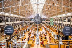 Time out market in Lisbon. LISBON, PORTUGAL - September 29, 2017: Interior view on the famous Time Out Market full of people in Lisbon city, Portugal royalty free stock photo