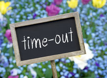 Time-out - wooden chalkboard with text royalty free stock photos