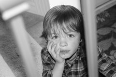 Time Out. Young boy sitting with a frown on his face Stock Images