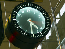 Time passing by. In a wall clock with blurred seconds hand royalty free stock image