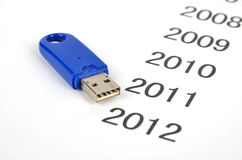 Time passing. A USB disk on a paper written years stock photo