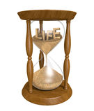 Time passing as sand in an old hourglass trickles down and life runs out. Old wooden sandglass with the word life inside. The sand is pouring into the bottom as Stock Photos