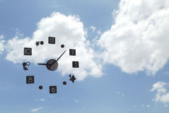 Time passing. Concept in cloudy sky background Royalty Free Stock Image