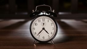 Time passing concept with vintage clock showing fast moving hands stock footage