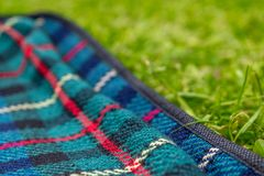 Time for picnic 1. Close up of a picnic rug and a grass Royalty Free Stock Photo