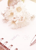 Time planner with pen. In diary , wedding day Royalty Free Stock Photo