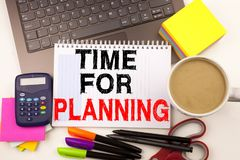 Time For Planning text in the office with surroundings such as laptop, marker, pen, stationery, coffee. Business concept for Busin. Ess time white background Royalty Free Stock Images
