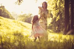 Time for playing. Mother and daughter outside. Spring season. Family time stock photos