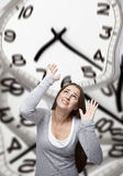Time pressure on a woman Royalty Free Stock Photos
