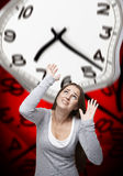 Time pressure on a woman with red background Stock Image