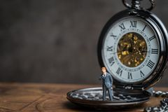 Time prove for business success concept, miniature people busine. Ssman standing on vintage pocket watch Stock Photography