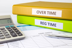 Daily time record with blank payroll time sheet stock photography