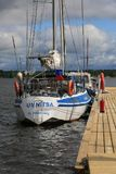 Russian yacht Umnitsa near a wooden pontoon berth on a cloudy day. Time of the regatta THE TALL SHIPS RASES Kotka 2017. Kotka, Finland Stock Images
