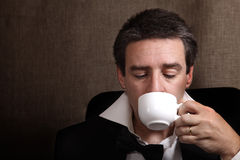 Time for relaxation. Picture of a man drinking coffe after celebration Royalty Free Stock Images