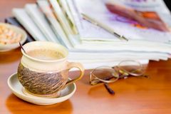 Time for relaxation. Cup of coffee and magazine Royalty Free Stock Photo