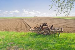 Time of relaxation for an agricultural equipment. (harrow) after spring field work Stock Photography
